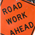 an-orange-road-sign-that-reads-road-work-ahead